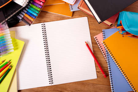 school supplies: College student desk with blank writing book, copy space