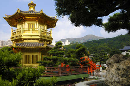 absolute: Golden Pagoda and red bridge in Nan Lian gardens, Kowloon, Hong Kong, also known as the Pavilion of Absolute Perfection.