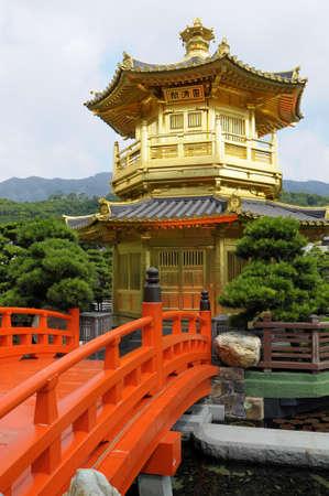 hong kong: Golden Pagoda with red bridge in Nan Lian gardens, Kowloon City, Hong Kong. Stock Photo