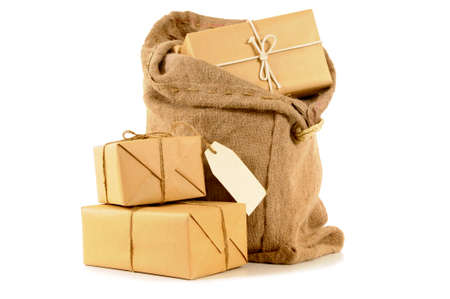 mail: Mail sack or bag with brown paper packages and address label Stock Photo