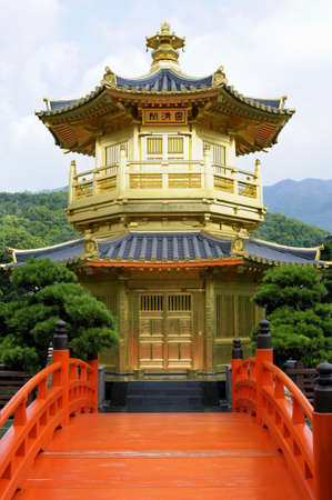 absolute: Golden Pagoda with red bridge in Nan Lian gardens, Kowloon City, Hong Kong, known as the Pavilion of Absolute Perfection.