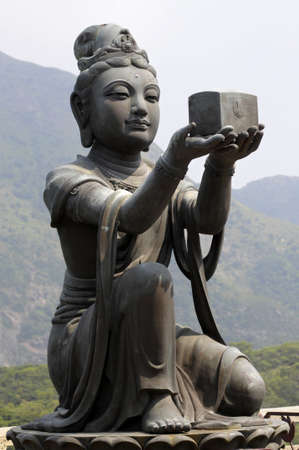 disciple: Female disciple statue offering a gift to the Big Buddha at Po Lin monastery, Lantau Island, Hong Kong. Stock Photo