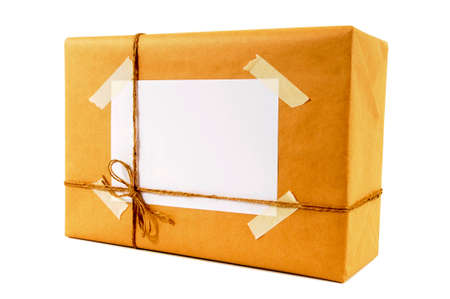 sticky tape: Brown paper packet with label and untidy sticky tape Stock Photo