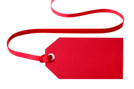 Red gift tag with red ribbon isolated on white.