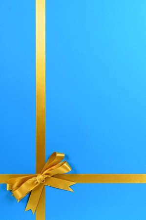gift ribbon: Gold gift ribbon on blue background.