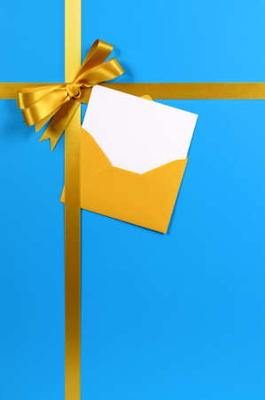 birthday invitation: Blue and gold gift with blank invitation or greetings card.