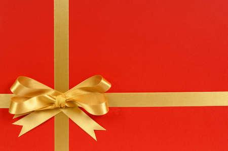 gift ribbon: Christmas gift border frame with gold ribbon and bow