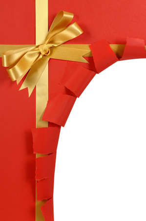 cut or torn paper: Untidy torn Christmas gift made from hand tied gold ribbon on red craft paper Stock Photo