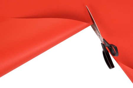 cut or torn paper: Scissors cutting red craft paper