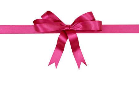 moño rosa: regalo de la cinta rosa y arco aislados sobre fondo blanco horizontal Foto de archivo