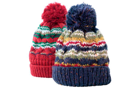 bobble: Two chunky knit bobble hats or knit hats isolated on a white background.