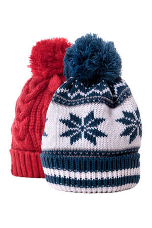 bobble: Two knitted bobble hats or ski hats isolated on a white background.