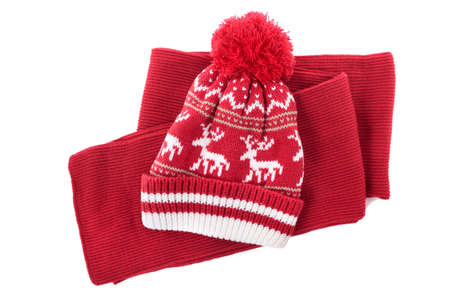 bobble: Red knitted scarf and winter bobble hat isolated on a white background