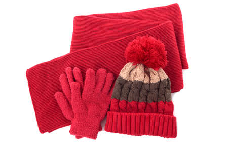 fleece: Red winter knitted bobble hat, scarf and gloves isolated on a white background