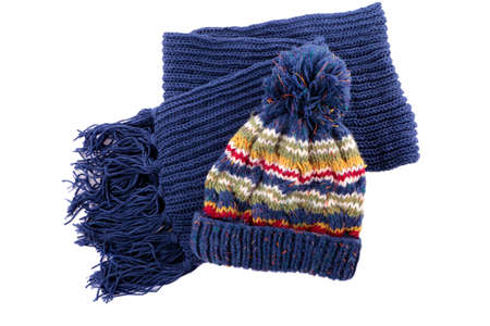 bobble: Chunky blue knitted winter bobble hat and scarf isolated on a white background