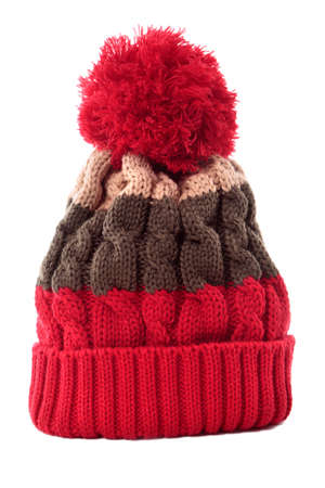 hats: Red striped bobble knit hat or ski hat isolated on a white background.