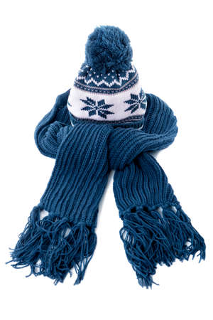 bobble: Blue knitted winter bobble hat and scarf isolated on a white background. Stock Photo