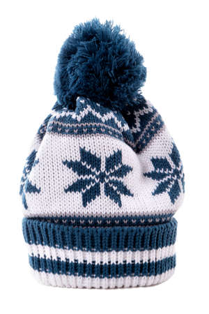 bobble: Blue knitted bobble hat or ski hat with snowflake pattern isolated on a white background.