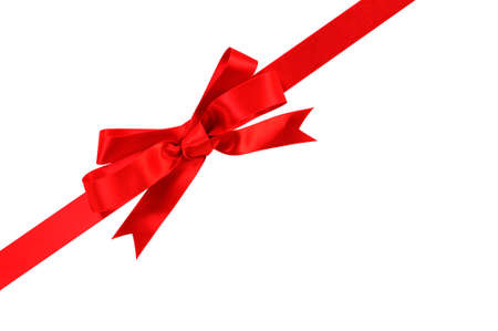 christmas isolated: Diagonal red gift bow and ribbon isolated on white background