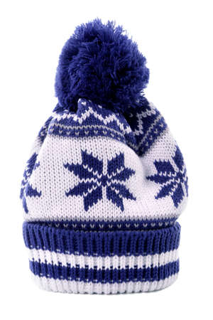 bobble: Blue bobble hat or knit hat with snowflake pattern isolated against a white background.
