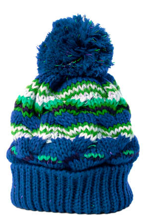 bobble: Blue bobble hat or knit hat isolated against a white background. Stock Photo
