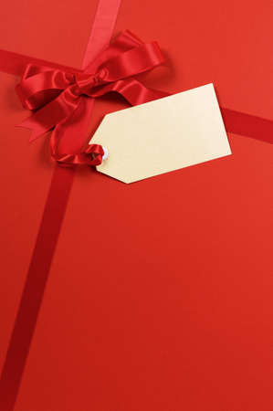christmas bow: Red gift ribbon and bow with blank tag or label