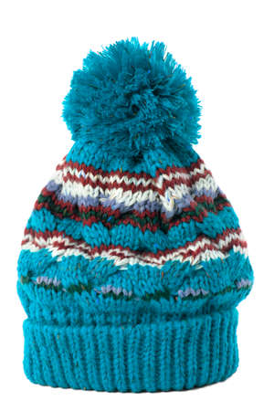 bobble: Blue knitted bobble hat or ski hat isolated on a white background.