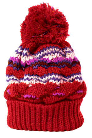 on a white background: Red bobble hat or knit hat isolated against a white background.
