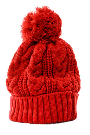 knit: Red bobble hat or knit hat isolated against a white background.