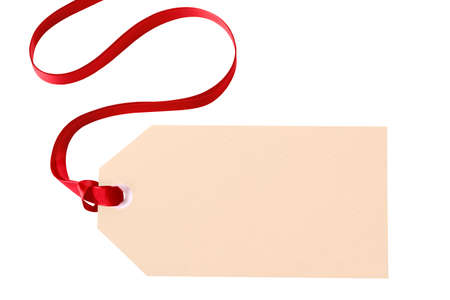 Plain gift tag with red ribbon isolated on white background Foto de archivo