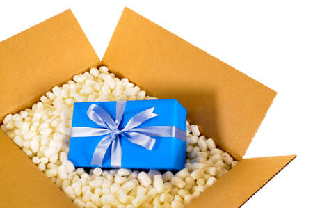 delivery box: Cardboard shipping delivery box with blue gift inside and polystyrene packing pieces.