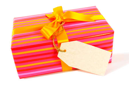christmas isolated: Candy stripe present with yellow gold ribbon and blank gift tag isolated on white background