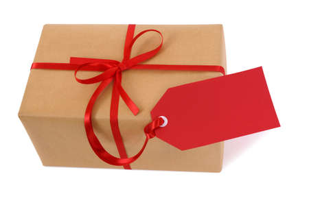 white red: Brown paper package or gift tied with red ribbon and gift tag isolated on white background
