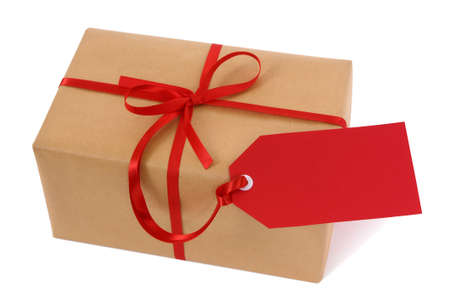 gift ribbon: Brown paper package or gift tied with red ribbon and gift tag isolated on white background