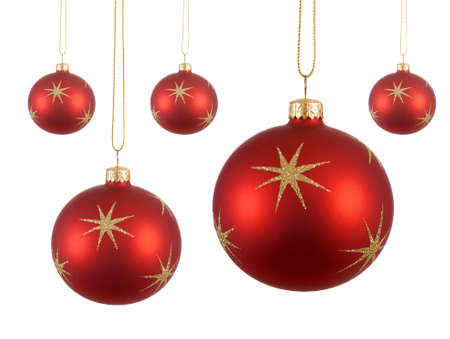 red and gold: Several red christmas balls or baubles with gold stars hanging isolated on white background