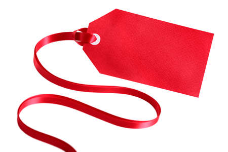 christmas isolated: Blank red gift tag with curly ribbon isolated on white background