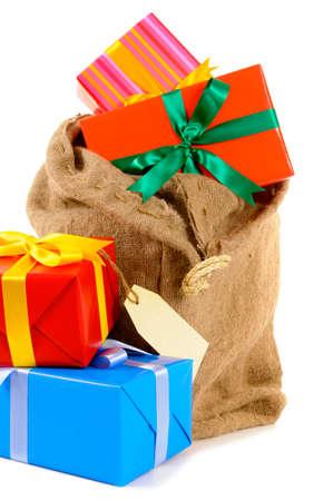 sackful: Santa sack full with pile of Christmas gifts isolated on white background
