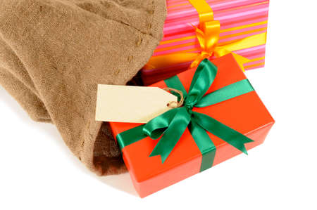 sackful: Mail bag or Santa sack full with Christmas gifts isolated on white background Stock Photo