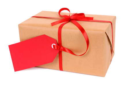 llanura: Brown paper package or gift tied with red ribbon and gift tag isolated on white background