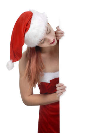 white poster: Smiling young adult woman in Santa hat holding plain white blank billboard or sign, shopping retail concept