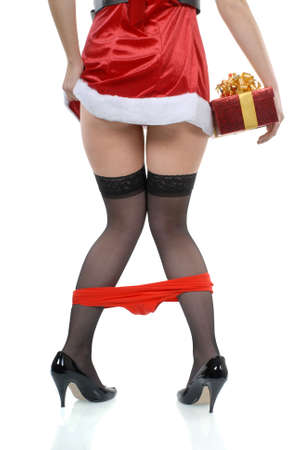 Red panties: Female santa party girl with panties falling down accident and red gift box isolated on white background Stock Photo