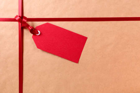 Red gift tag and ribbon Stock Photo