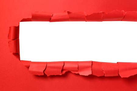 cut or torn paper: Torn red paper strip with white background copy space
