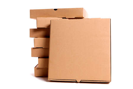 front facing: Stack of plain brown pizza boxes with one front facing box for display or advertising.  Space for copy. Stock Photo