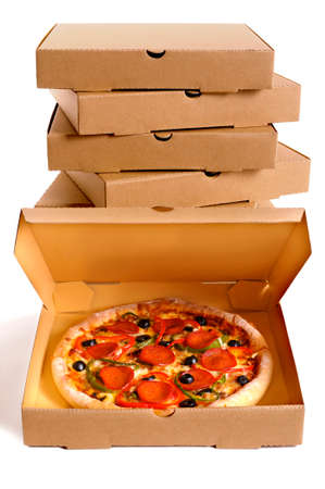 Pizza with a stack of delivery boxes isolated on a white background. Stock Photo