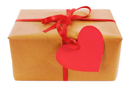 white heart: Valentine gift, brown paper parcel with red heart shape gift tag isolated on white background, close up.