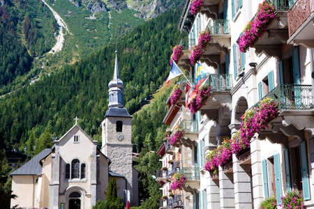 european alps: Church square, houses and hotel in the center of the ski resort town of Chamonix Mont Blanc, French Alps, France