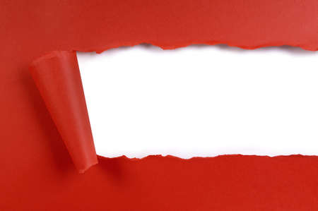 tearing: Torn strip red craft paper, white background, copy space Stock Photo