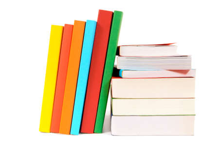 book spine: Small pile and leaning row of colorful books isolated on white