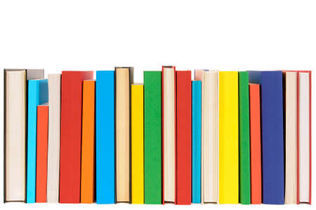 front view: Long row of colorful library books isolated on white background .